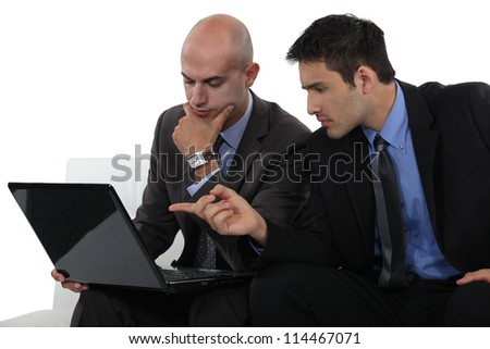 Two businessmen exchanging thoughts - stock photo