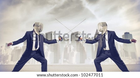 Two businessmen fencing with cityscape in the background - stock photo