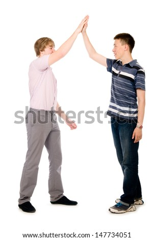 Two businessmen give each other a high five. - stock photo
