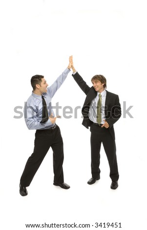 Two businessmen give each other a high five - stock photo
