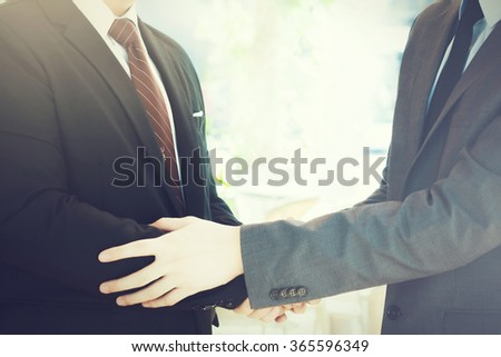 Two businessmen giving warm welcome, trust, teamwork, agreement to each other concept - stock photo