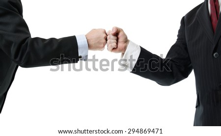 two businessmen greeting with a fist bump isolated on white - stock photo