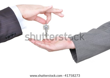 Two businessmen hands and the key