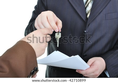 Two businessmen hands and the key, paper agreement - stock photo