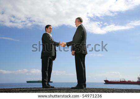 Two businessmen handshaking - stock photo