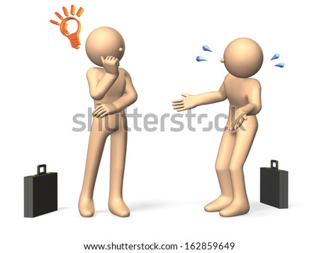 Two businessmen have a stand talking. One person is described something intently. - stock photo