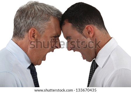 Two businessmen having an argument - stock photo