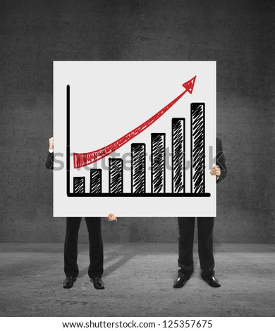 two businessmen holding a poster with growth of chart - stock photo