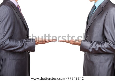 Two businessmen in elegant suits, standing and holding hands with palms up, presenting and showing empty copy space for product or text. Isolated over white background. Presenting concept.