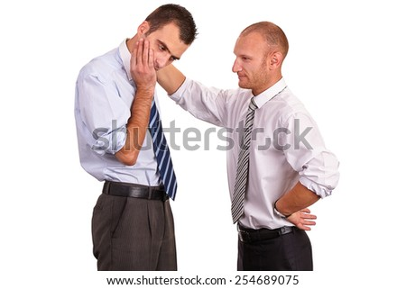 Two businessmen in shirts, troubled, one consoling, comforting and encouraging the other with a hand on his shoulder, isolated on white - stock photo