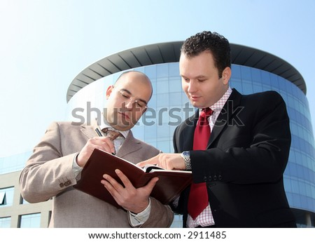 Two businessmen in the middle of conversation about job