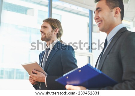 Two businessmen listening to lecture