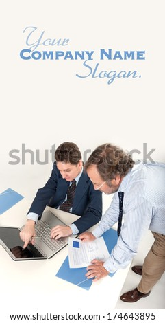 Two businessmen looking at a laptop  - stock photo