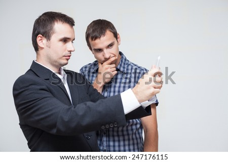 Two businessmen looking at digital tablet. - stock photo