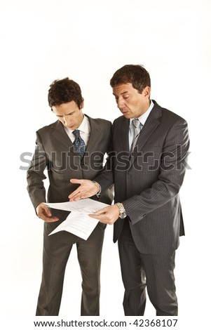 Two businessmen looking at documents - stock photo