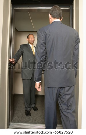 Two businessmen looking at each other - stock photo