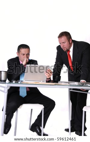 two businessmen meeting together and reviewing work