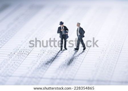 Two businessmen negotiating business terms - stock photo