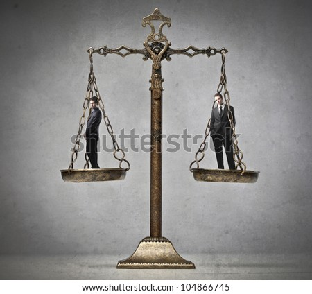 Two businessmen on a balance - stock photo
