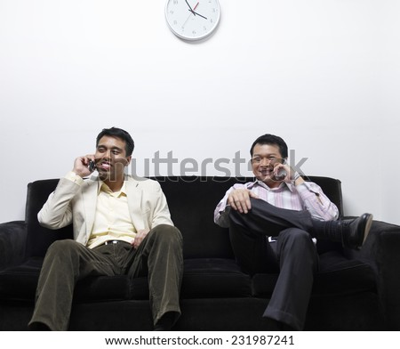 Two Businessmen on Cell Phones