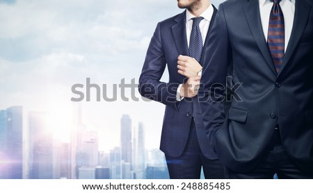 Two businessmen on megalopolis background - stock photo