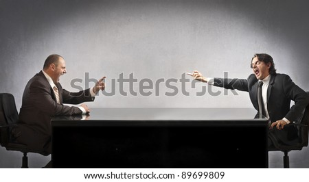 Two businessmen quarreling - stock photo