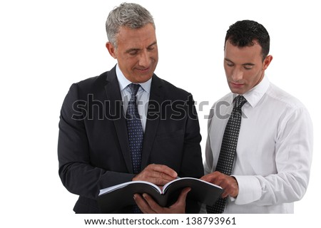 Two businessmen reading document - stock photo