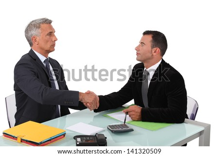 Two businessmen sealing the deal. - stock photo