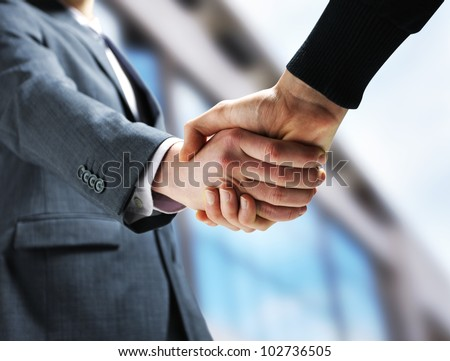 Two businessmen shaking hands. - stock photo