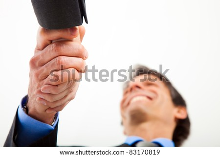 Two businessmen shaking hands - stock photo