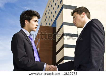 Two businessmen shaking hands in agreement - stock photo