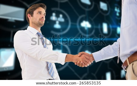 Two businessmen shaking hands in office against apps interface - stock photo