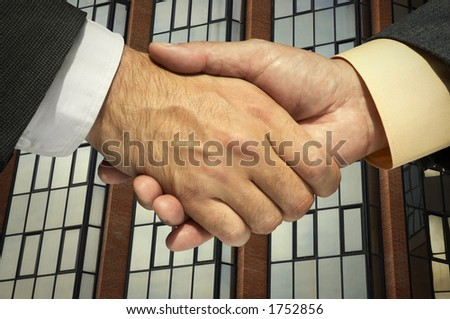 Two businessmen shaking hands on the corporative background(special photo f/x)