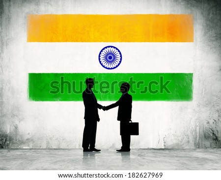 Two Businessmen Shaking Hands With Flag of India - stock photo