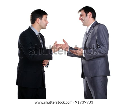 Two businessmen standing and talking and one of them smiling - stock photo