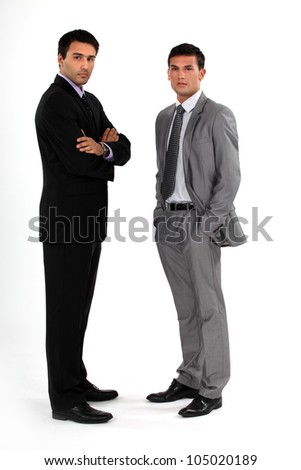 Two businessmen stood together - stock photo