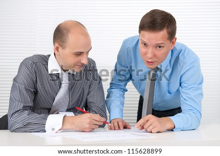 Two businessmen talking at a meeting. Teamwork
