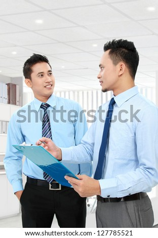 Two businessmen team discussing in the office - stock photo