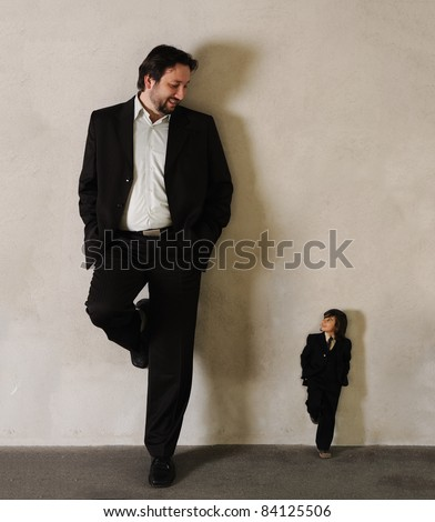 Two businessmen - Very very big and very small - stock photo