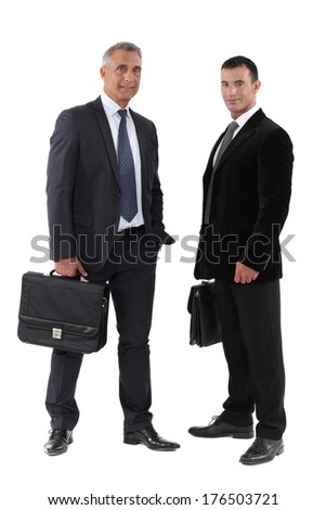 Two businessmen with briefcase - stock photo
