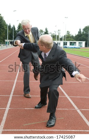 Two businessmen working as a team during a run. - stock photo