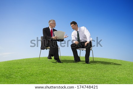 Two Businessmen Working Outdoors - stock photo
