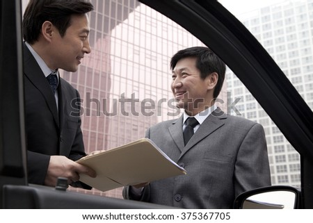 Two businessmen working outside - stock photo