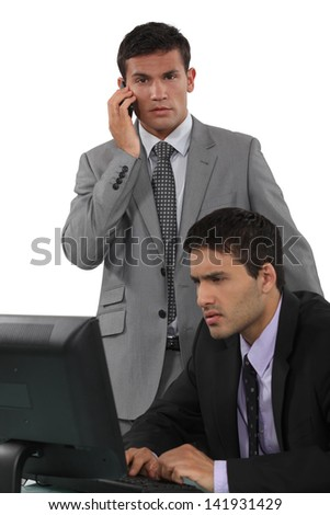two businessmen working together - stock photo