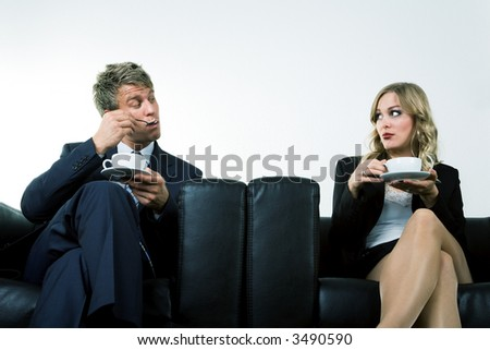 Two Businesspeople flirting in their coffee break
