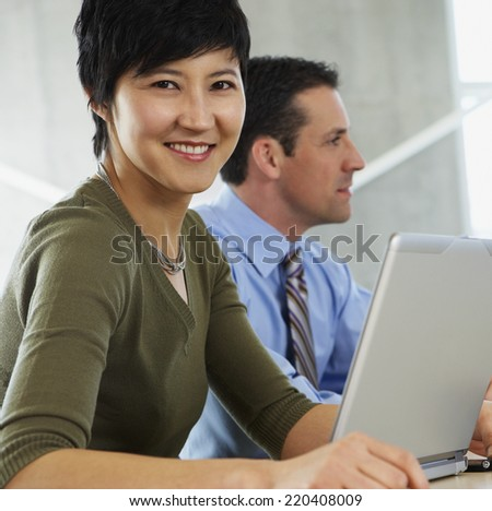 Two businesspeople in office - stock photo