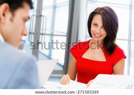 Two businesspeople working together in office