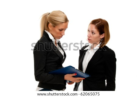 Two businesswoman discussing over a file isolated on white - stock photo