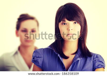 Two businesswoman isolated on white background - stock photo