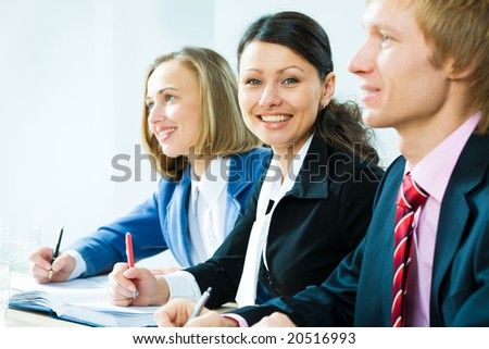 Two businesswomen and a businessman working in team - stock photo